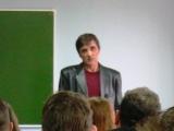 выступает Александр Моисеенко председатель портовой организации профсоюза докеров Морского пора СПб.